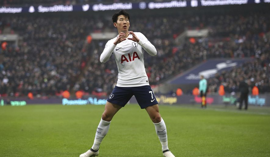 Tottenham Hotspur's Son Heung-Min celebrates scoring his side's first goal of the game against Huddersfield during their English Premier League soccer match at Wembley Stadium in London, Saturday March 3, 2018. (John Walton/PA via AP)