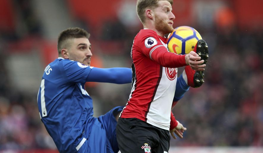 Stoke City's Kostas Stafylidis, left, and Southampton's Josh Sims in action during their English Premier League soccer match at St Mary's Stadium in Southampton, England, Saturday March 3, 2018. (Adam Davy/PA via AP)