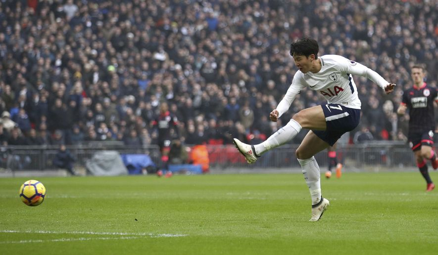 Tottenham Hotspur's Son Heung-Min scores his side's first goal of the game against Huddersfield, during their English Premier League soccer match at Wembley Stadium in London, Saturday March 3, 2018. (John Walton/PA via AP)