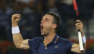 Roberto Batista Agut of Spain celebrates after defeating Malek Jaziri of Tunisia during a semi final match of the Dubai Duty Free Tennis Championship in Dubai, United Arab Emirates, Friday, March 2, 2018. (AP Photo/Kamran Jebreili)