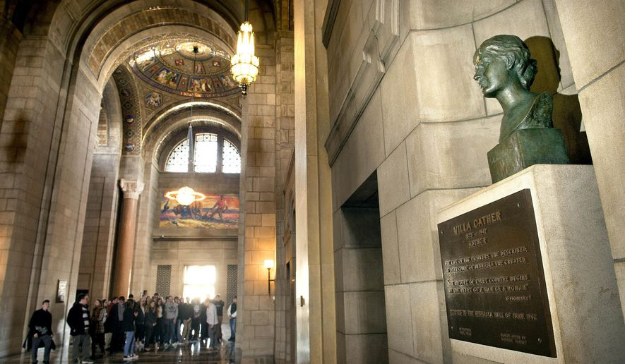 A bust of Nebraska author Willa Cather looks out over the Great Hall as a group tours the state capitol Wednesday, Feb. 21, 2018. If a Nebraska senator gets his way, Cather's image might also find a home in the nation's capitol.  (Eric Gregory/Lincoln Journal Star via AP)
