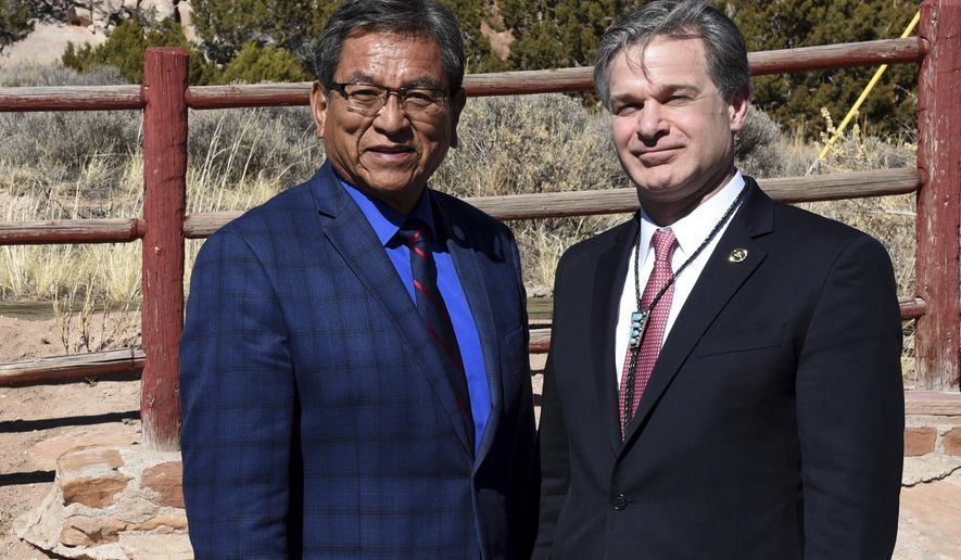 In this Friday, March 2, 2018, photo provided by the Federal Bureau of Investigations, shows Navajo Nation President Russell Begaye, left, with FBI Director Christopher Wray during a first visit to the tribal capital in Window Rock, Ariz.   Wray arrived in the tribal capital in Window Rock, Ariz., on Friday, March 2 and spoke with Navajo Nation President Russell Begaye and other tribal and federal law enforcement officials, including FBI agents from New Mexico. FBI spokesman Frank Fisher says Wray's visit to the Navajo Nation was the first by a director.  (FBI via AP)