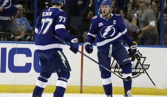 Tampa Bay Lightning center Steven Stamkos (91) celebrates his goal against the Philadelphia Flyers with defenseman Victor Hedman (77) during the first period of an NHL hockey game Saturday, March 3, 2018, in Tampa, Fla. (AP Photo/Chris O'Meara)