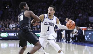 Villanova's Jalen Brunson, right, makes his move on Georgetown's Trey Dickerson, left, during the first half of an NCAA college basketball game, Saturday, March 3, 2018, in Philadelphia. (AP Photo/Chris Szagola)