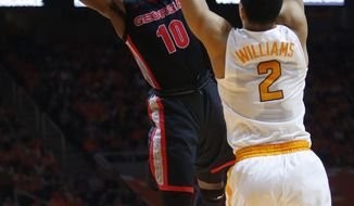 Georgia guard Teshaun Hightower (10) is defended by Tennessee forward Grant Williams (2) during the first half of an NCAA college basketball game Saturday, March 3, 2018, in Knoxville, Tenn. (AP Photo/Crystal LoGiudice)