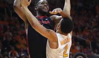 Georgia forward Yante Maten looks for a shot over Tennessee forward Grant Williams (2) during the first half of an NCAA college basketball game Saturday, March 3, 2018, in Knoxville, Tenn. (AP Photo/Crystal LoGiudice)