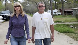 This Feb. 28, 2018 photo shows Charmaine Rea, left, and her business partner Manuel Perez in Dickinson, Texas.  They are upset with a zoning change on Holly Drive that will allow the owners of Dickinson Bar-B-Que & Steakhouse and Marais to build a parking lot.  (Jennifer Reynolds/The Galveston County Daily News via AP)