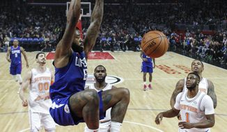 Los Angeles Clippers center DeAndre Jordan dunks against New York Knicks during the first half of an NBA basketball game Friday, March 2, 2018, in Los Angeles. (AP Photo/Ringo H.W. Chiu)