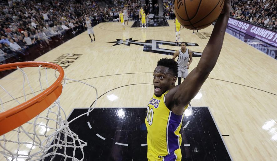Los Angeles Lakers forward Julius Randle (30) scores against the San Antonio Spurs during the first half of an NBA basketball game, Saturday, March 3, 2018, in San Antonio. (AP Photo/Eric Gay)