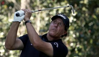 Phil Mickelson, of the U.S., watches his shot on the 17th hole during the third round of the Mexico Championship at the Chapultepec Golf Club in in Mexico City, Saturday, March 3, 2018. (AP Photo/Eduardo Verdugo)