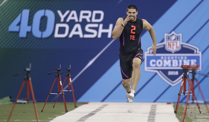 Oklahoma tight end Mark Andrews runs the 40-yard dash during the NFL football scouting combine, Saturday, March 3, 2018, in Indianapolis. (AP Photo/Darron Cummings)