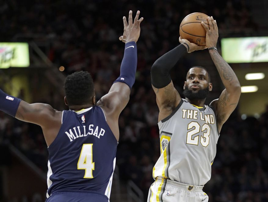 Cleveland Cavaliers' LeBron James (23) shoots over Denver Nuggets' Paul Millsap (4) in the first half of an NBA basketball game, Saturday, March 3, 2018, in Cleveland. (AP Photo/Tony Dejak)