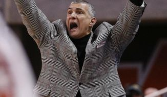 South Carolina head coach Frank Martin gestures on the sideline during the first half of an NCAA college basketball game against Auburn, Saturday, March 3, 2018, in Auburn, Ala. (AP Photo/Brynn Anderson)