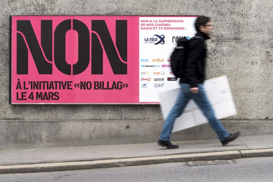 """FILE - In this Feb. 9, 2018 photo a man passes by a sign asking to vote in the """"No Billag"""" initiative in Fribourg, Switzerland. Swiss voters can decide in a referendum on March 4, 2018 on a proposal to stop the mandatory licence fee for services of the Swiss Broadcasting Corporation.  (Anthony Anex/Keystone via AP)"""
