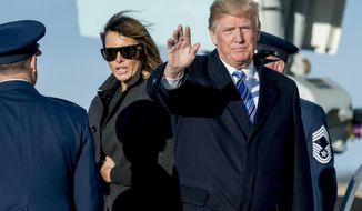 President Donald Trump, accompanied by first lady Melania Trump, waves to members of the media as they arrive at Andrews Air Force Base, Md., Saturday, March 3, 2018 to board Marine One for a short trip to the White House. (AP Photo/Andrew Harnik)