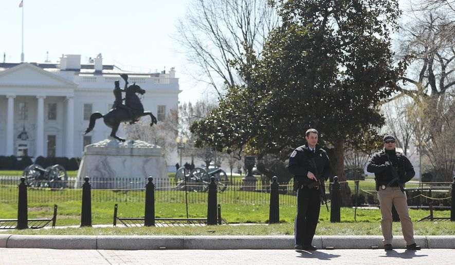 Law enforcement officers at Lafayette Park across from the White House in Washington, take up positions as they close the area to pedestrian traffic, Saturday, March 3, 2018. (AP Photo/Pablo Martinez Monsivais) ** FILE **