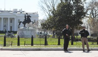 Law enforcement officers at Lafayette Park across from the White House in Washington, take up positions as they close the area to pedestrian traffic, Saturday, March 3, 2018.    The Secret Service says a man shot himself outside the White House, and medical personnel are on the scene. President Donald Trump is not at the White House,  he's in Florida, but is set to return later Saturday. The agency says in a Twitter post that there are no other reported injuries related to the incident.   (AP Photo/Pablo Martinez Monsivais)