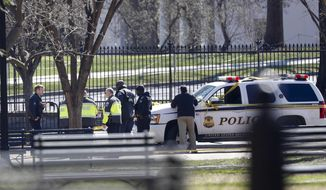 Law enforcement officers gather infront of the White House in Washington, Saturday, March 3, 2018.    The Secret Service says a man shot himself outside the White House, and medical personnel are on the scene. President Donald Trump is not at the White House,  he's in Florida, but is set to return later Saturday. The agency says in a Twitter post that there are no other reported injuries related to the incident.   (AP Photo/Pablo Martinez Monsivais)