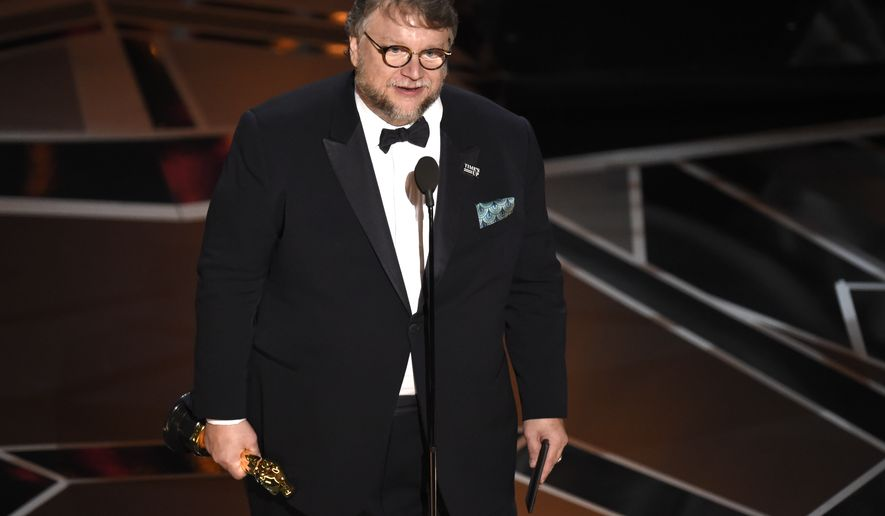 "Guillermo del Toro accepts the award for best director for ""The Shape of Water"" at the Oscars on Sunday, March 4, 2018, at the Dolby Theatre in Los Angeles. (Photo by Chris Pizzello/Invision/AP)"