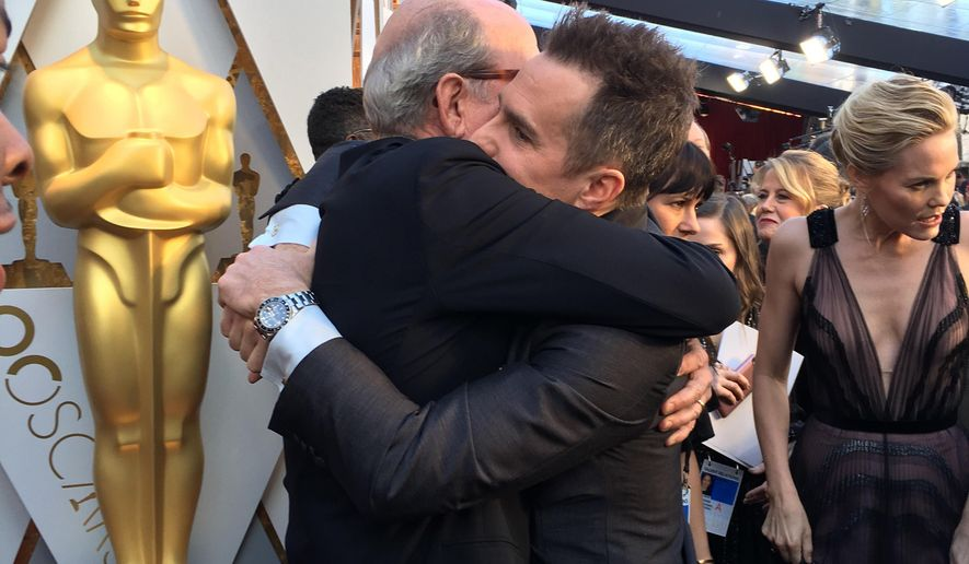 Best supporting actor nominees Richard Jenkins, left, and Sam Rockwell embrace on the red carpet at the 90th Annual Academy Awards on Sunday, March 4, 2018 at the Dolby Theatre in Los Angeles. (AP Photo/Sandy Cohen)