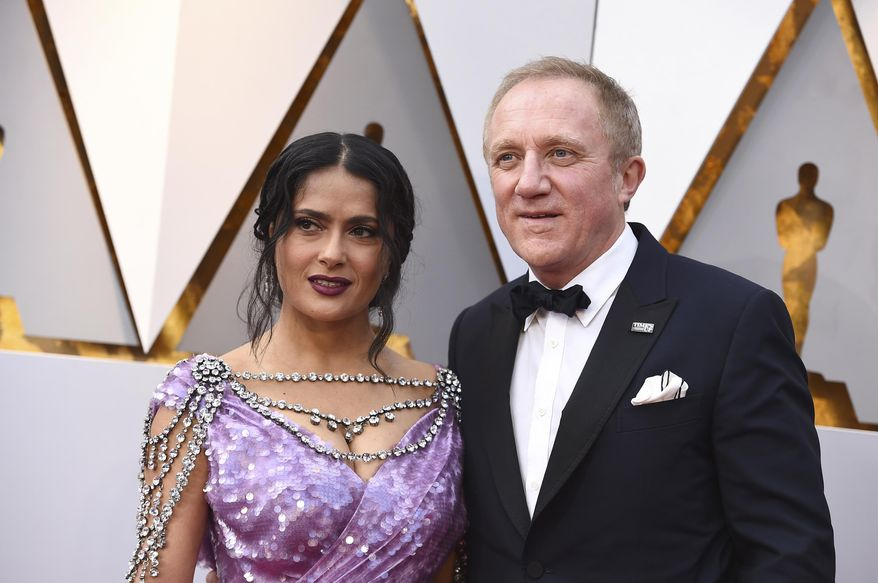 Salma Hayek, left, and Francois-Henri Pinault arrive at the Oscars on Sunday, March 4, 2018, at the Dolby Theatre in Los Angeles. (Photo by Jordan Strauss/Invision/AP)