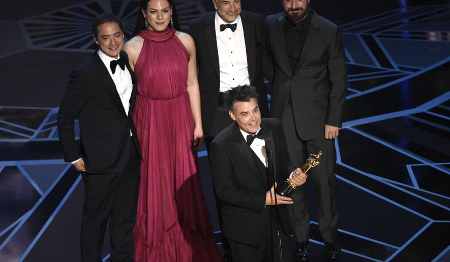 """Sebastian Lelio, foreground center, and Nicolas Saavedra, from back left, Daniela Vega, Alejandro Goic, and Pablo Larrain accept the award for best foreign language film for """"A Fantastic Woman"""" at the Oscars on Sunday, March 4, 2018, at the Dolby Theatre in Los Angeles. (Photo by Chris Pizzello/Invision/AP)"""