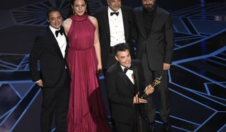 "Sebastian Lelio, foreground center, and Nicolas Saavedra, from back left, Daniela Vega, Alejandro Goic, and Pablo Larrain accept the award for best foreign language film for ""A Fantastic Woman"" at the Oscars on Sunday, March 4, 2018, at the Dolby Theatre in Los Angeles. (Photo by Chris Pizzello/Invision/AP)"