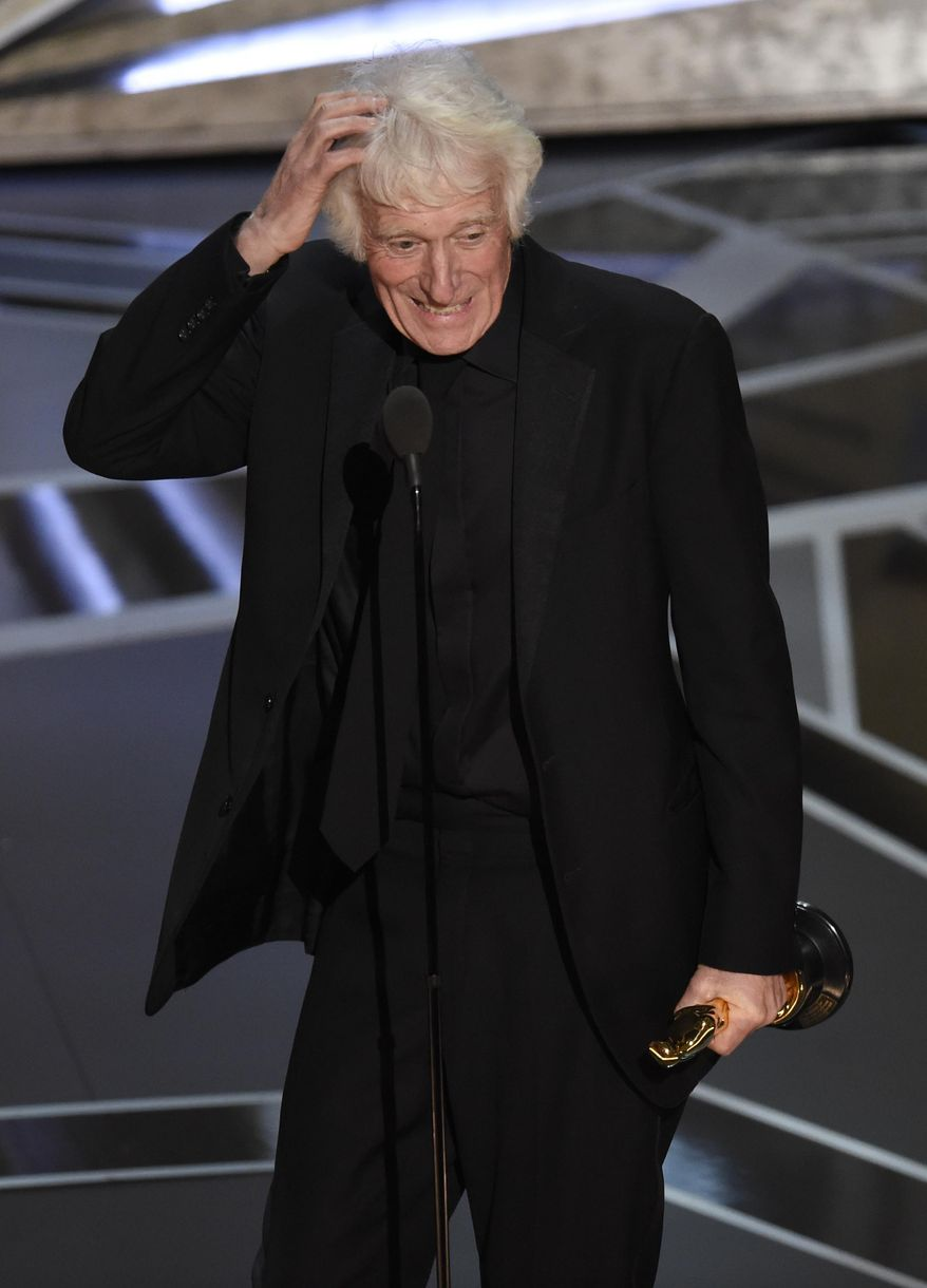 """CORRECTS FILM TITLE TO BLADE RUNNER 2049 - Roger Deakins accepts the award for best cinematography for """"Blade Runner 2049"""" at the Oscars on Sunday, March 4, 2018, at the Dolby Theatre in Los Angeles. (Photo by Chris Pizzello/Invision/AP)"""