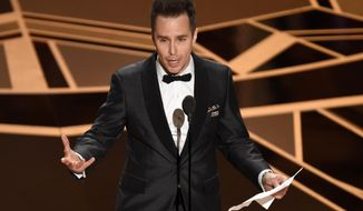 "Sam Rockwell accepts the award for best performance by an actor in a supporting role for ""Three Billboards Outside Ebbing, Missouri"" at the Oscars on Sunday, March 4, 2018, at the Dolby Theatre in Los Angeles. (Photo by Chris Pizzello/Invision/AP)"