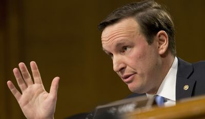 Sen. Chris Murphy, D-Conn., poses a question to Secretary of State-designate Rex Tillerson during testimony before the Senate Foreign Relations Committee on Capitol Hill in Washington, Wednesday, Jan. 11, 2017, (AP Photo/Steve Helber)