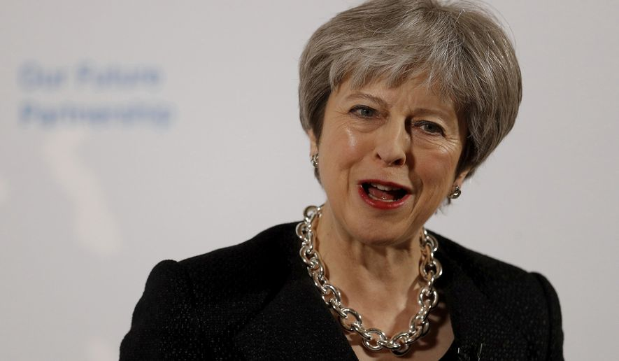 Britain's Prime Minister Theresa May delivers a speech at the Mansion House in London, Friday March 2, 2018. May promised to tell an impatient European Union on Friday what Britain is prepared to give and what it wants to take in a post-Brexit trade deal with the bloc. (Peter Nicholls/Pool Photo via AP)