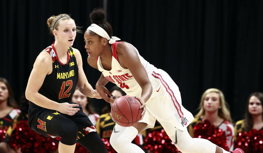 Ohio State guard Sierra Calhoun, right, dribbles the basketball defended by Maryland guard Kristen Confroy during the first half of an NCAA college basketball game in the finals of the Big Ten conference tournament, Sunday, March 4, 2018, in Indianapolis. (AP Photo/R Brent Smith)