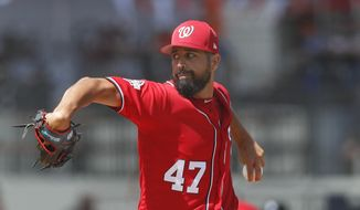 Washington Nationals starting pitcher Gio Gonzalez works in the first inning of a spring training baseball game against the Detroit Tigers, Sunday, March 4, 2018, in West Palm Beach, Fla. (AP Photo/John Bazemore)