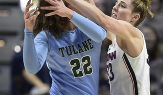 Connecticut's Katie Lou Samuelson, right, pushes the ball out of the hands of Tulane's MeredithSchulte during the first half of an NCAA college basketball game in the American Athletic Conference tournament quarterfinals, Sunday, March 4, 2018, in Uncasville, Conn. (AP Photo/Jessica Hill)