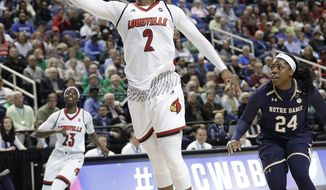 Louisville's Myisha Hines-Allen (2) drives past Notre Dame's Arike Ogunbowale (24) during the first half of an NCAA college basketball game in the championship of the women's Atlantic Coast Conference tournament in Greensboro, N.C., Sunday, March 4, 2018. (AP Photo/Chuck Burton)
