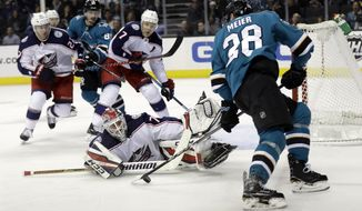 Columbus Blue Jackets goaltender Sergei Bobrovsky, bottom center, stops a shot from Timo Meier (28) during the second period of an NHL hockey game, Sunday, March 4, 2018, in San Jose, Calif. (AP Photo/Marcio Jose Sanchez)