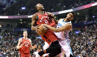 Toronto Raptors forward C.J. Miles (0) collides with Charlotte Hornets guard Jeremy Lamb on his way to the basket during the first half of an NBA basketball game, Sunday, March 4, 2018, in Toronto. (Frank Gunn/The Canadian Press via AP) **FILE**