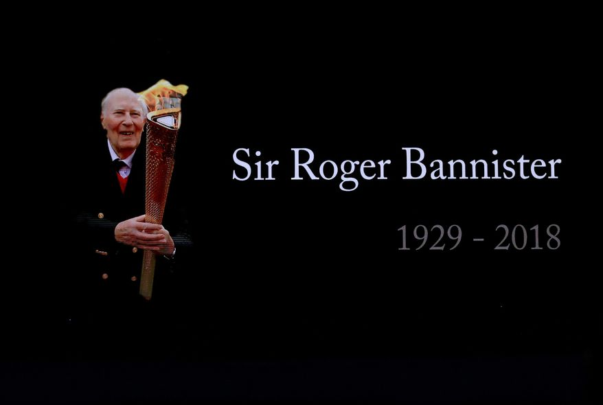 A video screen shows a tribute to Roger Bannister at the World Athletics Indoor Championships in Birmingham, Britain, Sunday, March 4, 2018. Bannister, the first person to run a mile in under four minutes, died March 3. (AP Photo/Matt Dunham)