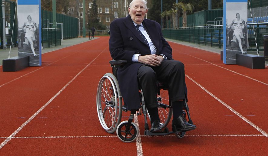 FILE - In tis file photo dated Wednesday, Feb. 26, 2014, former British athlete Roger Bannister poses for a picture during the launch of the Westminster Mile run, to celebrate the 60th anniversary of Bannister's record of being the first man to run a sub-four minute mile in May 1954, at Paddington Recreation Ground in London.  A statement released Sunday March 4, 2018, on behalf of Bannister's family said Sir Roger Bannister died peacefully in Oxford on March 3, aged 88.  (AP Photo/Sang Tan)