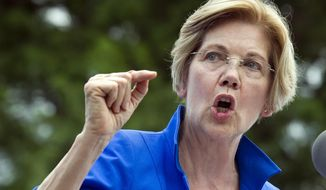 Sen. Elizabeth Warren, Massachusetts Democrat, is working to defuse an issue that has dogged her for years, her claims of Native American heritage, ahead of a possible run for president in 2020. (AP Photo/Cliff Owen, File)