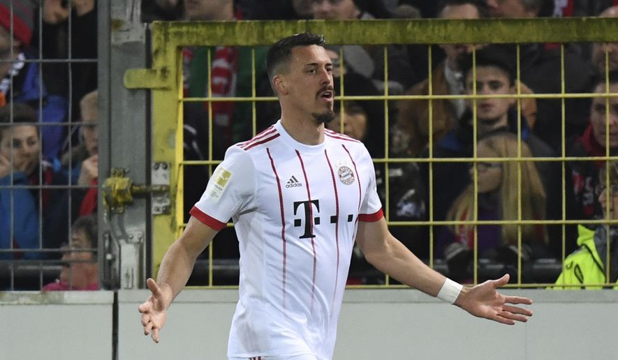 Munich's Sandro Wagner  celebrates his side's third goal during the German Bundesliga soccer match between SC Freiburg and Bayern Munich, in Freiburg, Germany, Sunday, March 4, 2018. (Patrick Seeger/dpa via AP)