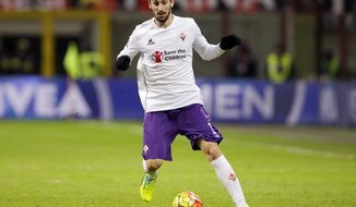 FILE - In this Sunday, Jan. 17, 2016 filer, Fiorentina's Davide Astori goes for the ball during the Serie A soccer match between AC Milan and Fiorentina at the San Siro stadium in Milan, Italy. Fiorentina captain Davide Astori has died, the club has announced. He was 31. Astori was found in the early hours of Sunday morning in his hotel room in Udine, where the team was staying ahead of an Italian league match. (AP Photo/Antonio Calanni, File)