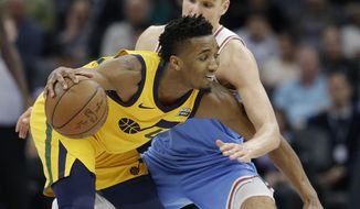 Utah Jazz guard Donovan Mitchell, left, tries to get past Sacramento Kings guard Bogdan Bogdanovic during the second quarter of an NBA basketball game Saturday, March 3, 2018, in Sacramento, Calif. (AP Photo/Rich Pedroncelli)
