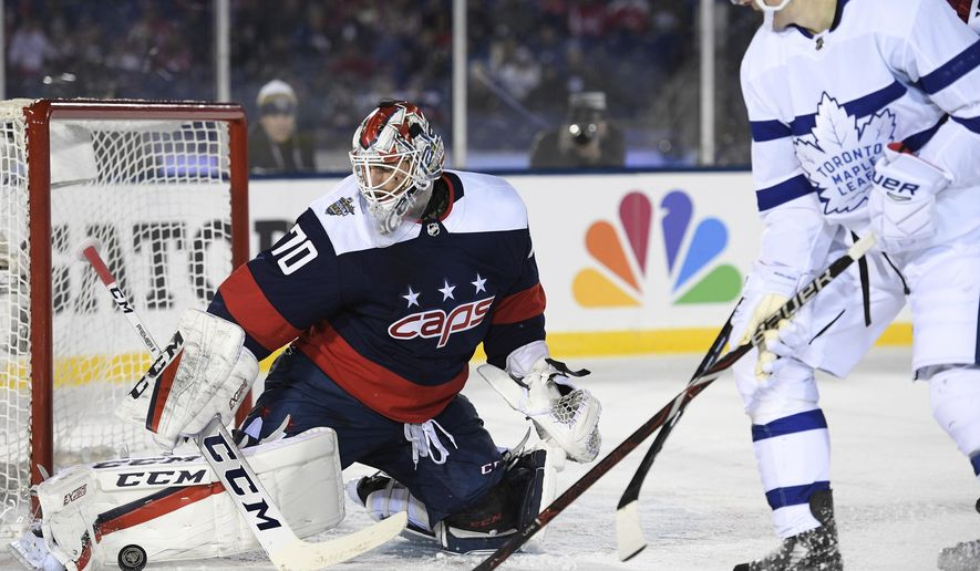 ce88f82114e Washington Capitals goaltender Braden Holtby (70) stops the puck against  Toronto Maple Leafs center