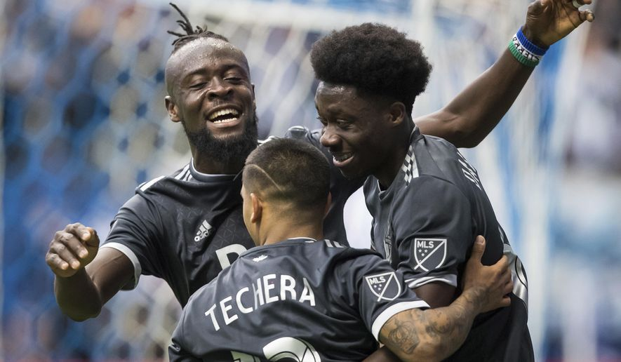 Vancouver Whitecaps' Kei Kamara, back left, Cristian Techera, front, and Alphonso Davies celebrate Davies' goal against the Montreal Impact during the second half of an MLS soccer game in Vancouver, British Columbia, Sunday, March 4, 2018. (Darryl Dyck/The Canadian Press via AP)