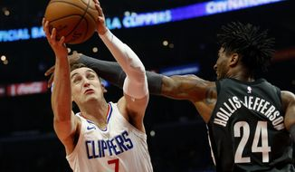 Los Angeles Clippers forward Sam Dekker, left, gets fouled by Brooklyn Nets forward Rondae Hollis-Jefferson during the first half of an NBA basketball game, Sunday, March 4, 2018, in Los Angeles. (AP Photo/Ringo H.W. Chiu) ** FILE **