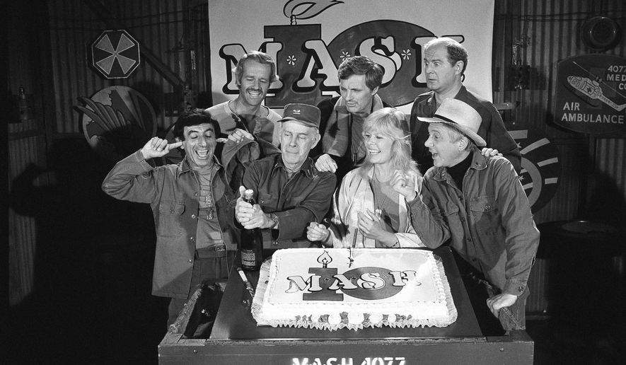 "FILE - In this Oct. 22, 1981, file photo, Jamie Farr, from front left, plugs his ears as cast members of the ""M.A.S.H."" television series cast Harry Morgan, Loretta Swit, William Christopher and, from back from left, Mike Farrell, Alan Alda and David Ogden Stiers celebrate during a party on the set of the popular CBS program in Los Angeles. Stiers a prolific actor best known for playing a surgeon on the television series ""M.A.S.H."" has died, the actor's agent Mitchell Stubbs confirmed Saturday night, March 4, 2018, in an email. He was 75. (AP Photo/Huynh, File)"
