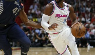 Miami Heat guard Dwyane Wade (3) drives past Detroit Pistons forward Anthony Tolliver (43) during the second half of an NBA basketball game, Saturday, March 3, 2018, in Miami. (AP Photo/Wilfredo Lee)