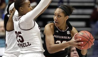 South Carolina forward A'ja Wilson, right, is defended by Mississippi State's Zion Campbell (25) in the first half of the NCAA college basketball championship game at the women's Southeastern Conference tournament Sunday, March 4, 2018, in Nashville, Tenn. (AP Photo/Mark Humphrey)