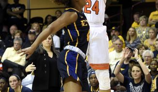 Mercer guard Kahlia Lawrence (24 goes up for a basket against East Tennessee State guard Jada Craig (10) in the first half of an NCAA college basketball game in the Southern Conference tournament championship on Sunday, March 4, 2018, in Asheville, N.C. (AP Photo/Kathy Kmonicek)
